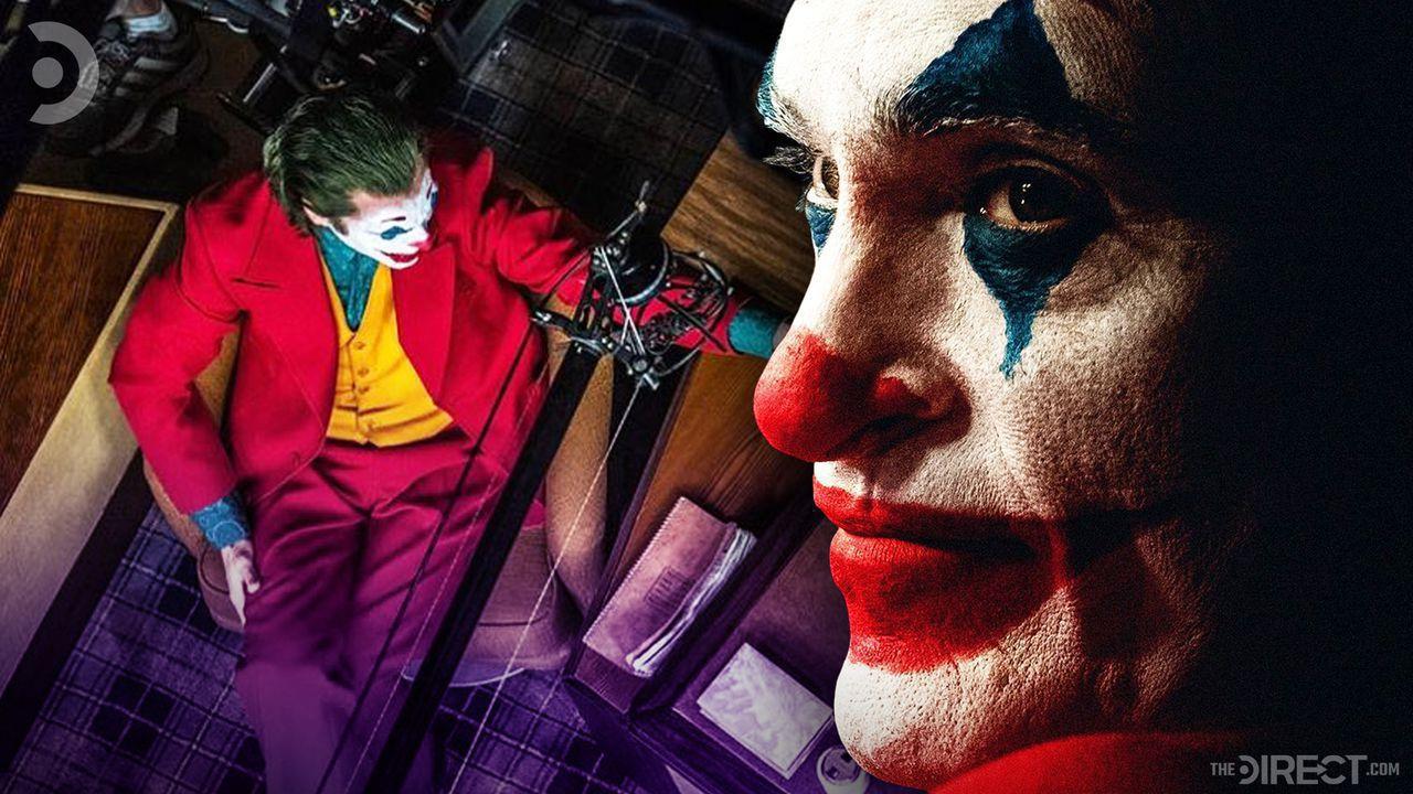 Overhead of Joker holding a gun, close up of Joaquin Phoenix as Joker