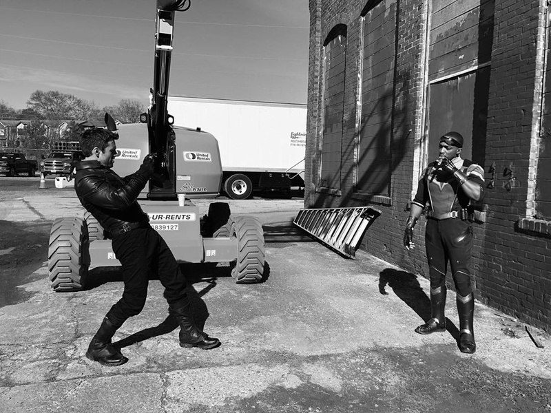 Sebastian Stan taking a picture of Anthony Mackie