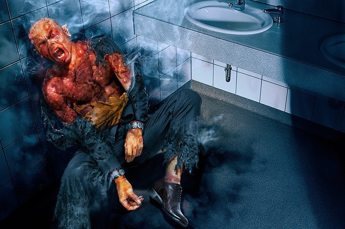 Etrigan beginning to transform in public bathroom