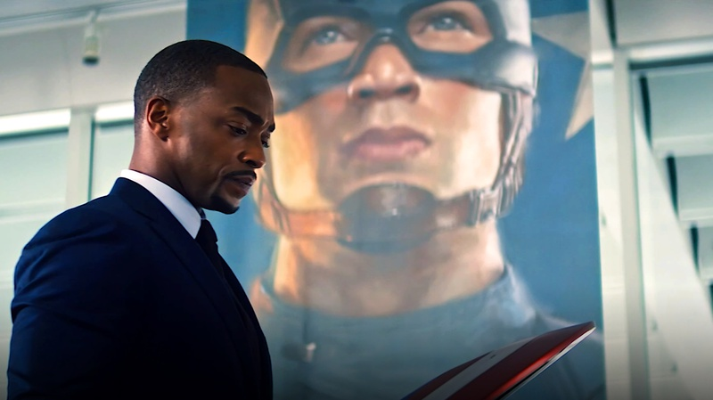Falcon with Captain America banner behind him