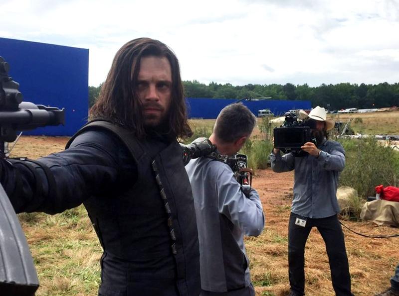 Sebastian Stan as Bucky Barnes holding Sean Gunn